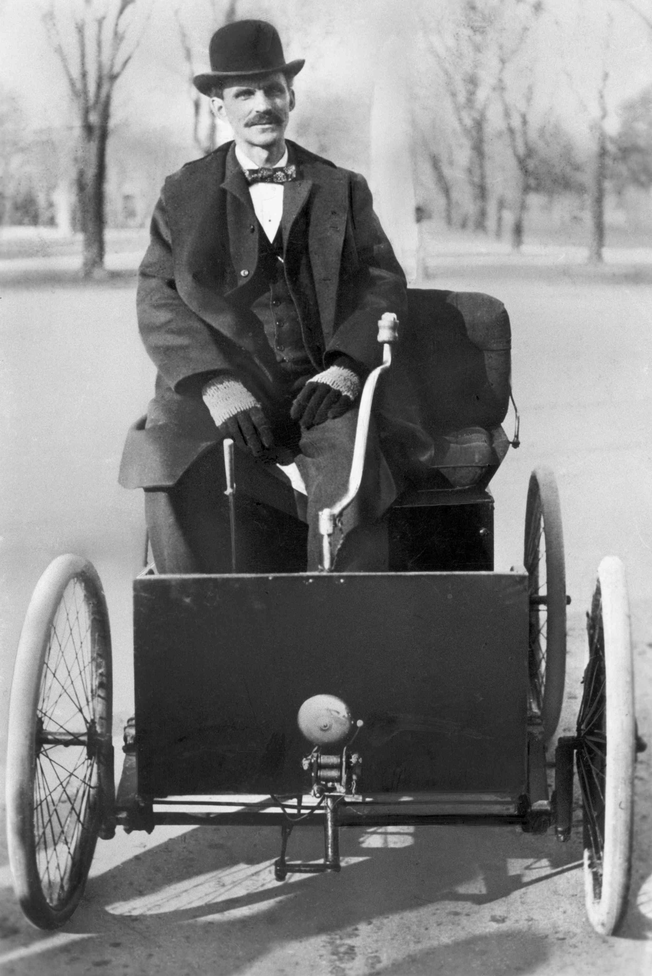 Henry Ford Seated In His First Ford Auto