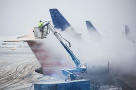 Jet airliners being de-iced before takeoff