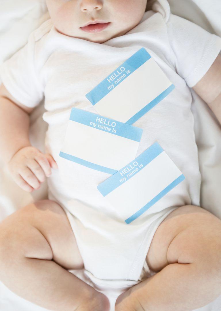 infant with name tags