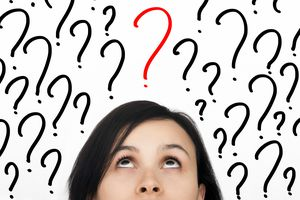 a woman looking up at a question mark