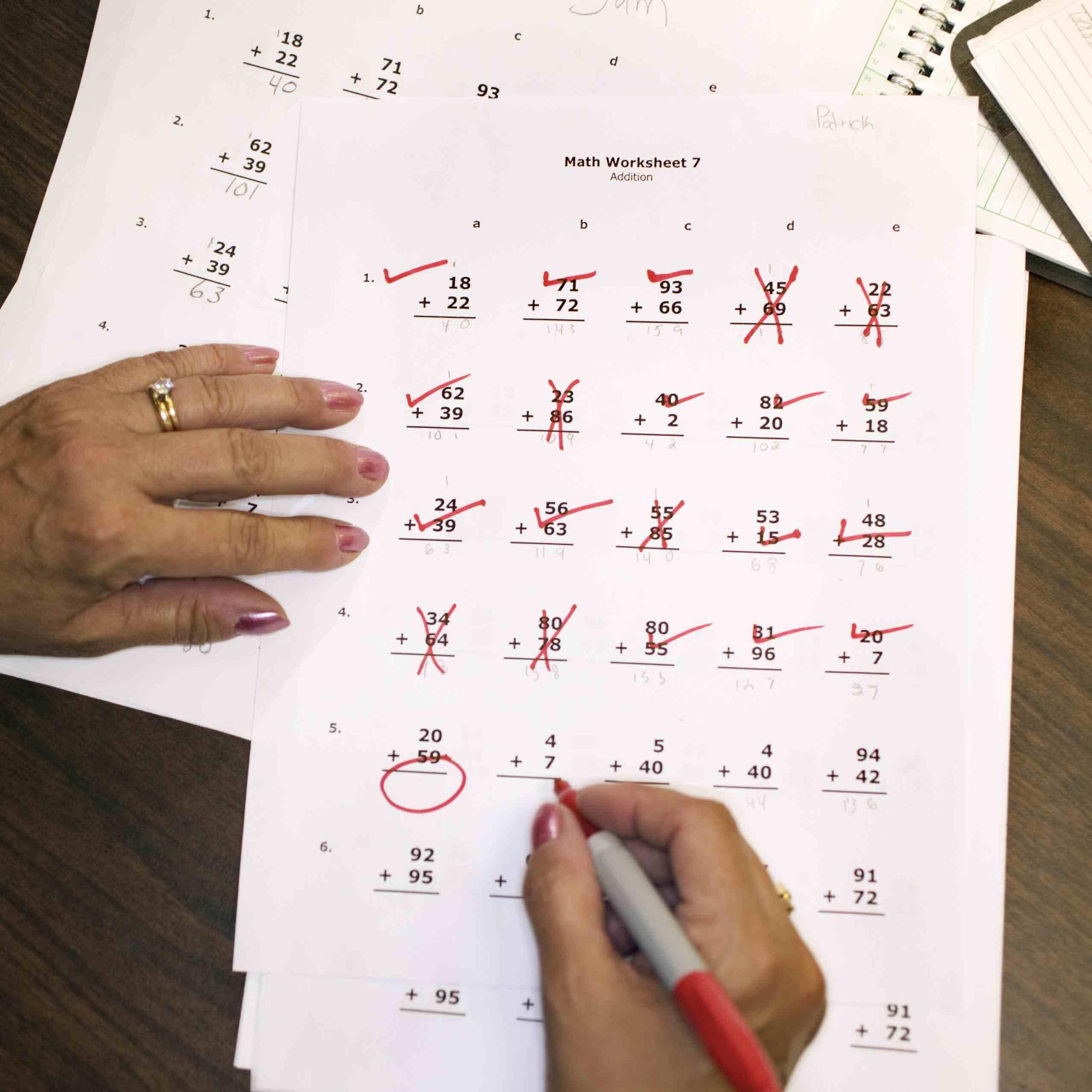 Teacher grading math homework