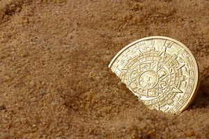 Aztec coin in the sand