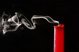 Extinguished candle and smoke