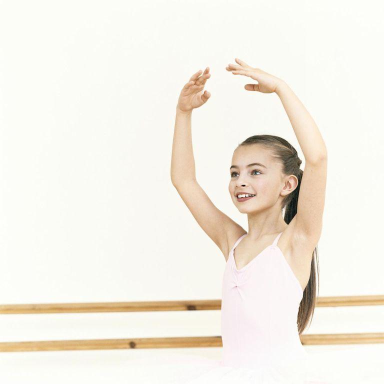oung, Female Ballet Dancer Practicing in a Dance Studio