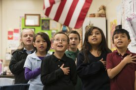 A group of elementary students saying the Pledge of Allegiance