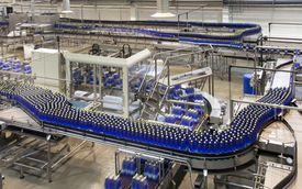 Bottles on production line in bottling pla... By: