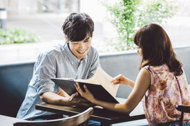Young couple looking at menu in cafe.