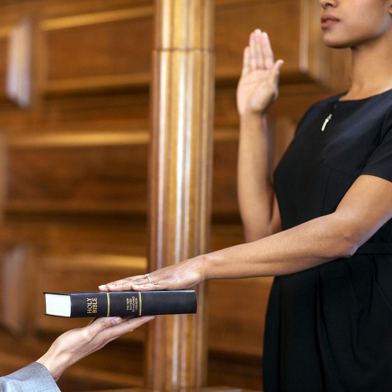 Woman swearing an Oath in Court