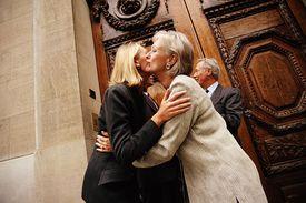 Women exchange kisses in greeting