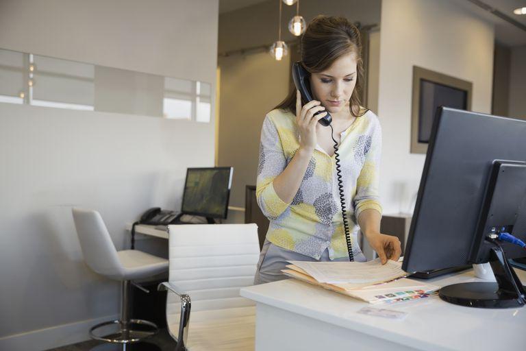 Receptionist standing at desk