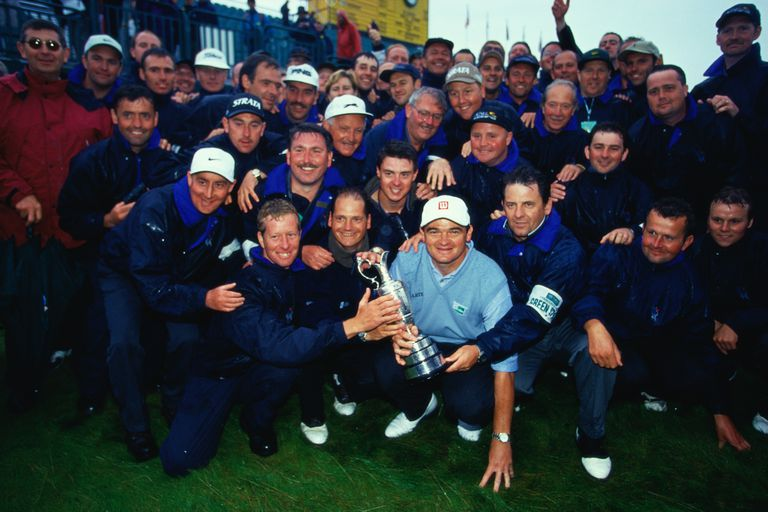 Paul Lawrie poses with the trophy with the green staff after winning the British Open Golf Championship 1999