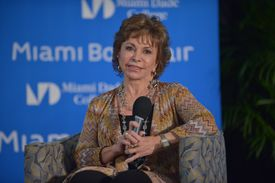 Isabel Allende sitting onstage with a microphone