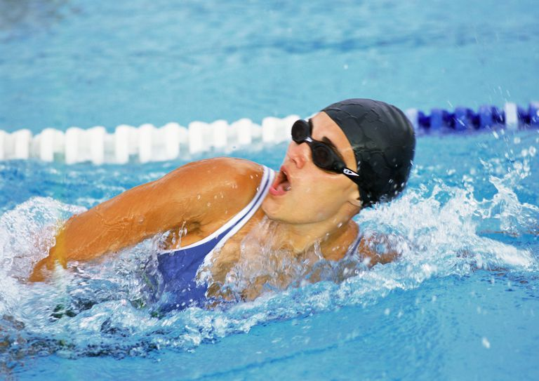Female swimmer taking breath, close-up