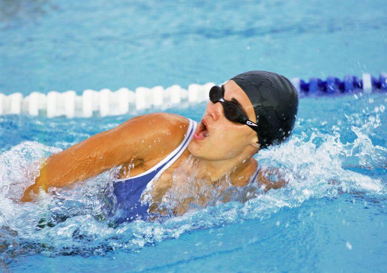 Female swimmer taking breath, close-up