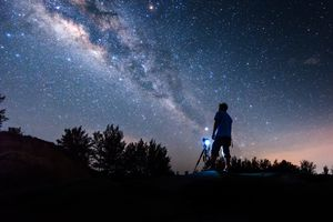 Silhouette Man Standing Against Star Field