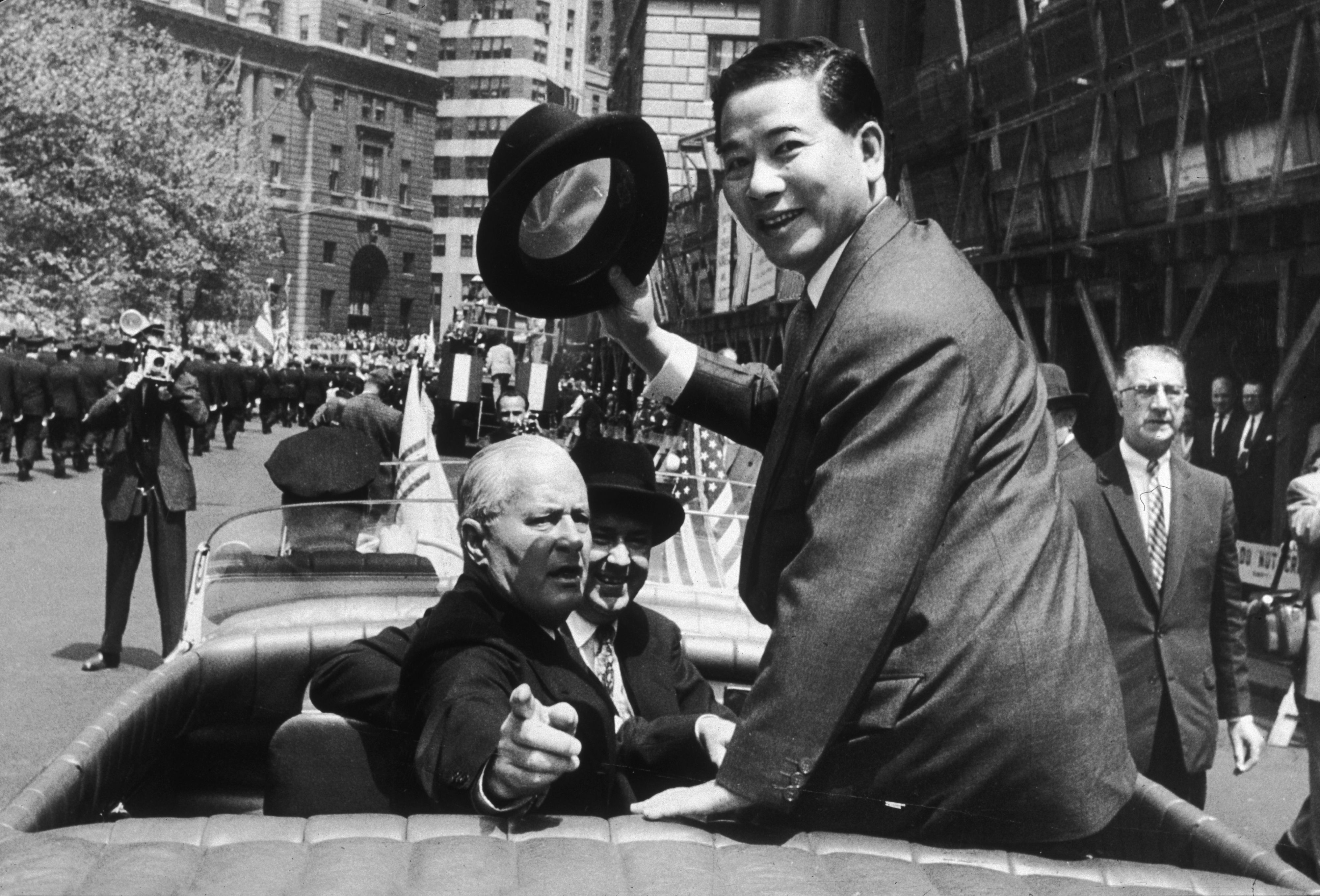 South Vietnamese President Ngo Dinh Diem rides with Commissioner Richard Patterson and Chief Protocol of the State Department, Wiley T. Buchanan Jr. in a parade in New York City.
