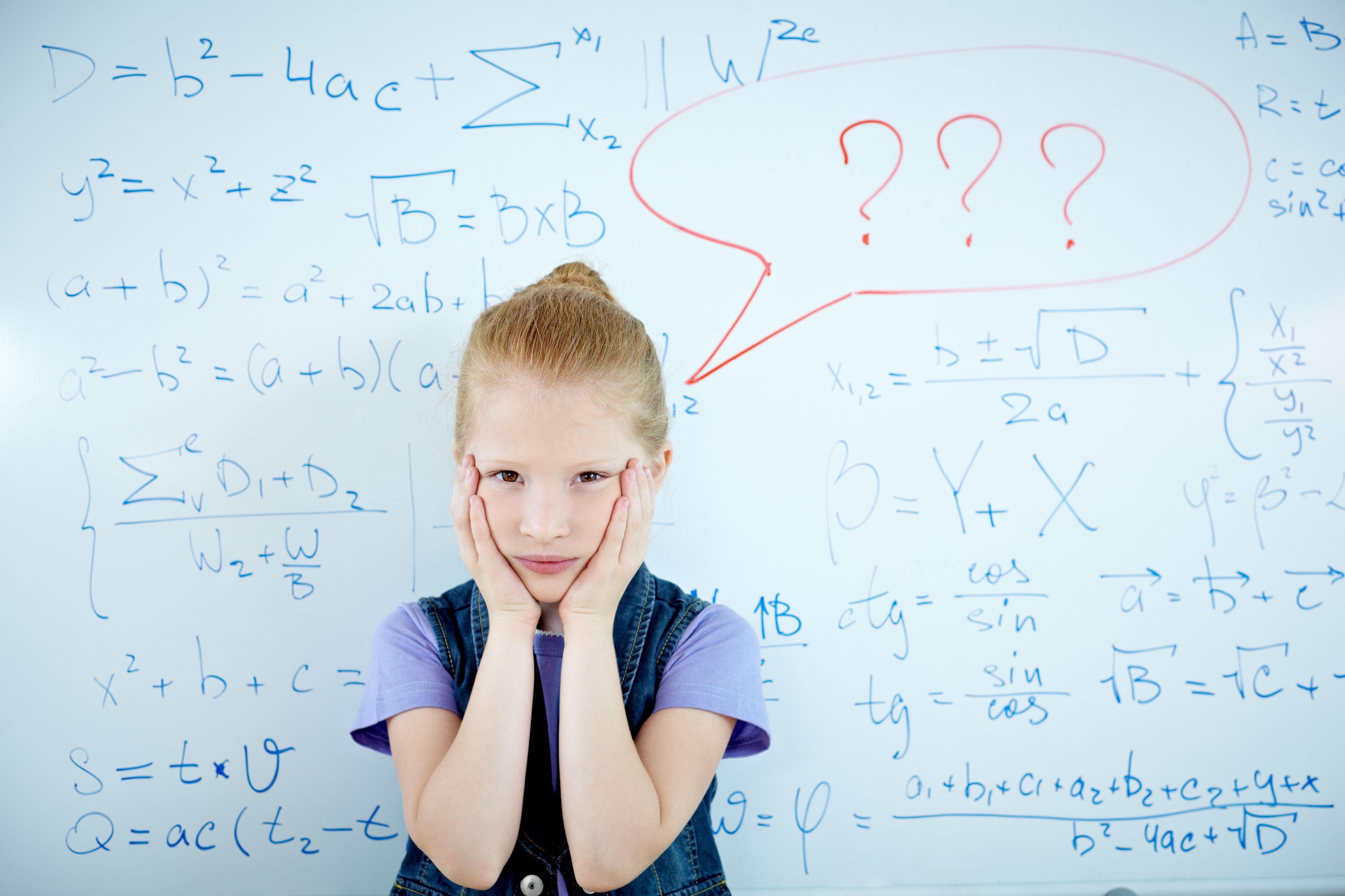 Confused girl in front of math whiteboard