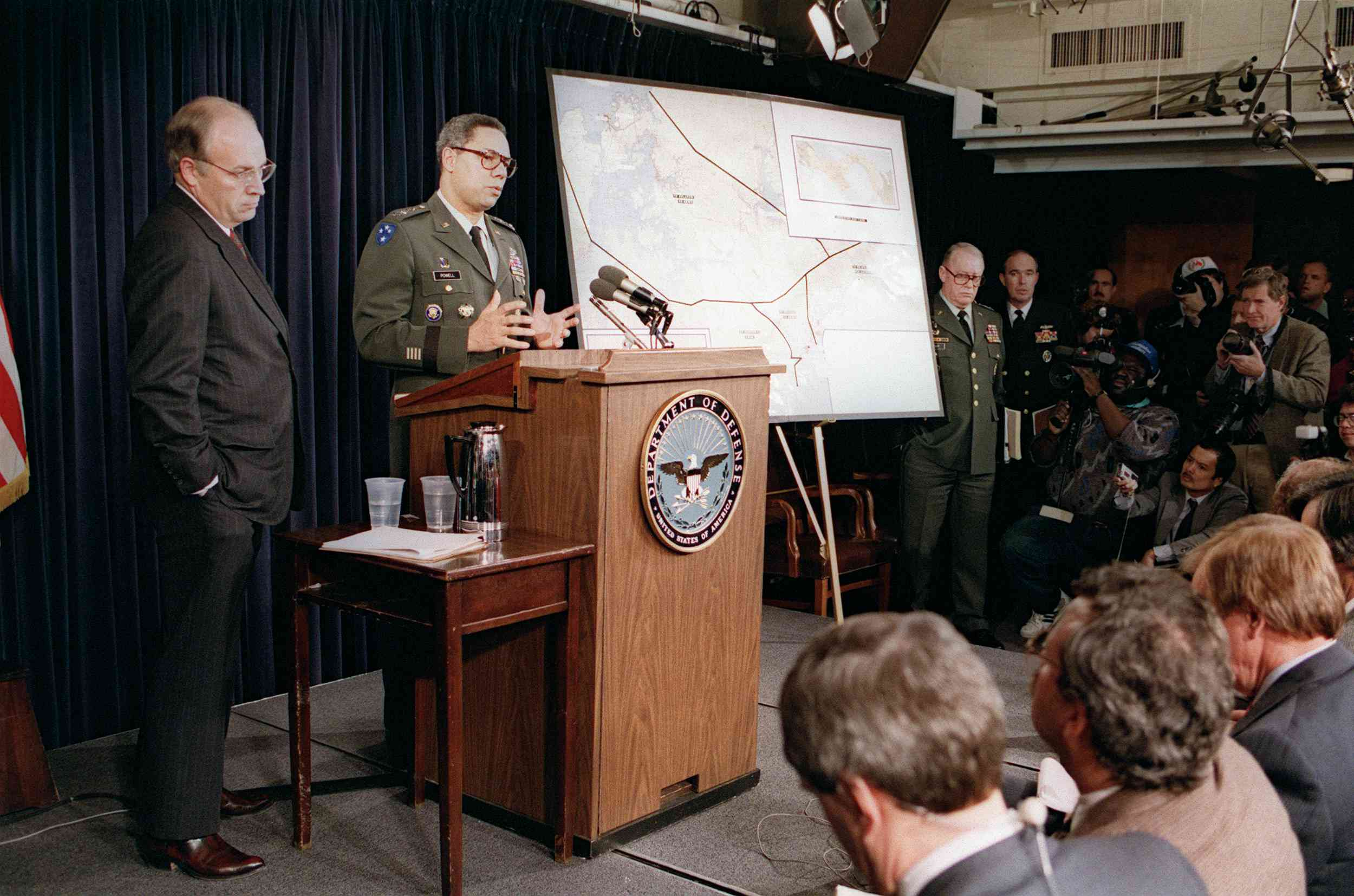 US Defense Secretary Dick Cheney (L) stands by as