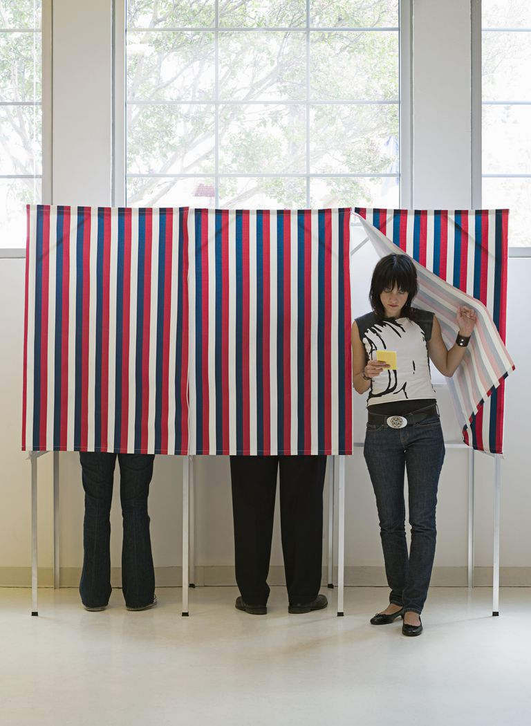 Hipster emerging from voting booth