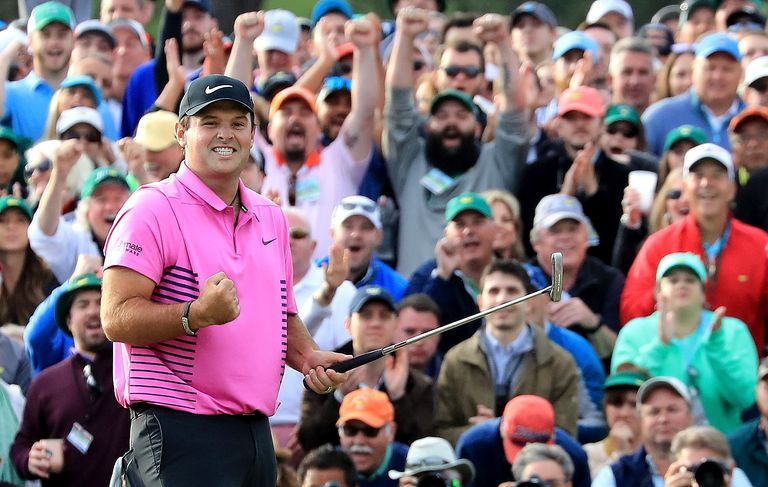 Patrick Reed of the United States celebrates after making par on the 18th green during the final round to win the 2018 Masters Tournament