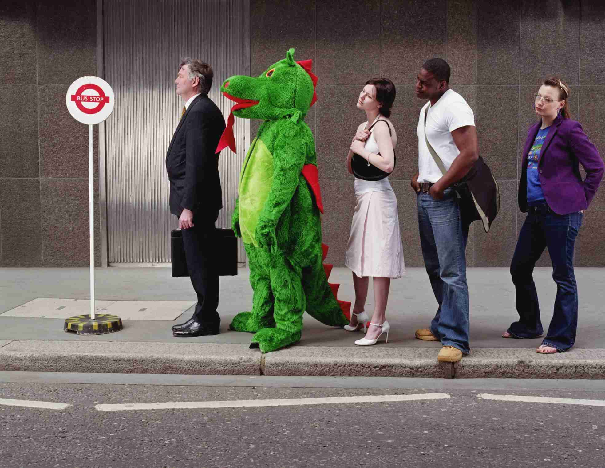 A person dressed in a dragon costume demonstrates non-conformity to social norms and pressures.