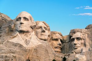Low Angle View Of Statues At Mount Rushmore National Memorial Against Sky