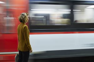 Businesswoman looking at train passing by
