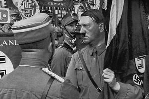 """Hitler holding the """"Blood Flag"""" at the 1934 Reich Party Day"""