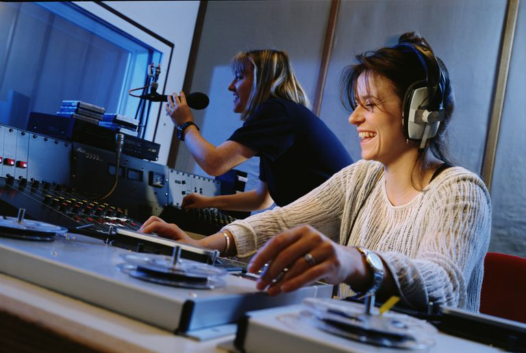 Two female disc jockeys in a radio station