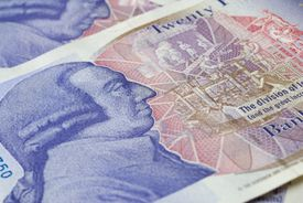 Close up of the Back of a New British Twenty Pound Note showing Adam Smith's head.