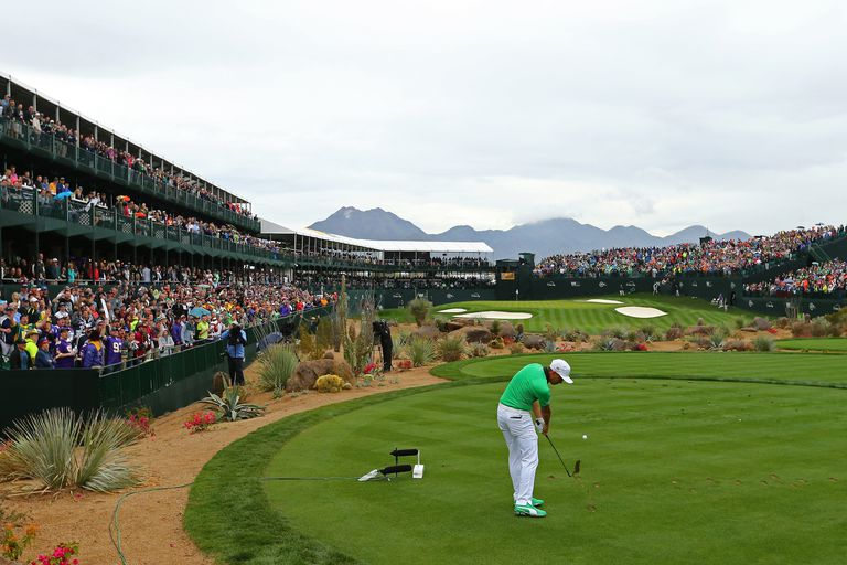 Rickie Fowler hits a tee shot on the 16th hole during the third round of the Waste Management Phoenix Open at TPC Scottsdale on January 31, 2015