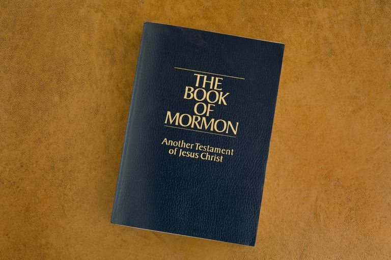 Book of Mormon on a leather desktop.
