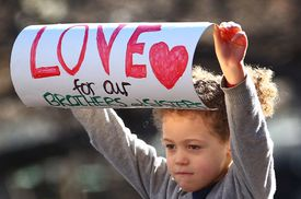 Child holding a protest sign in Australia Black Lives Matter rallies