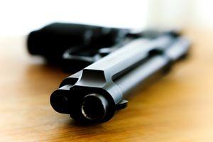A black pistol on a table
