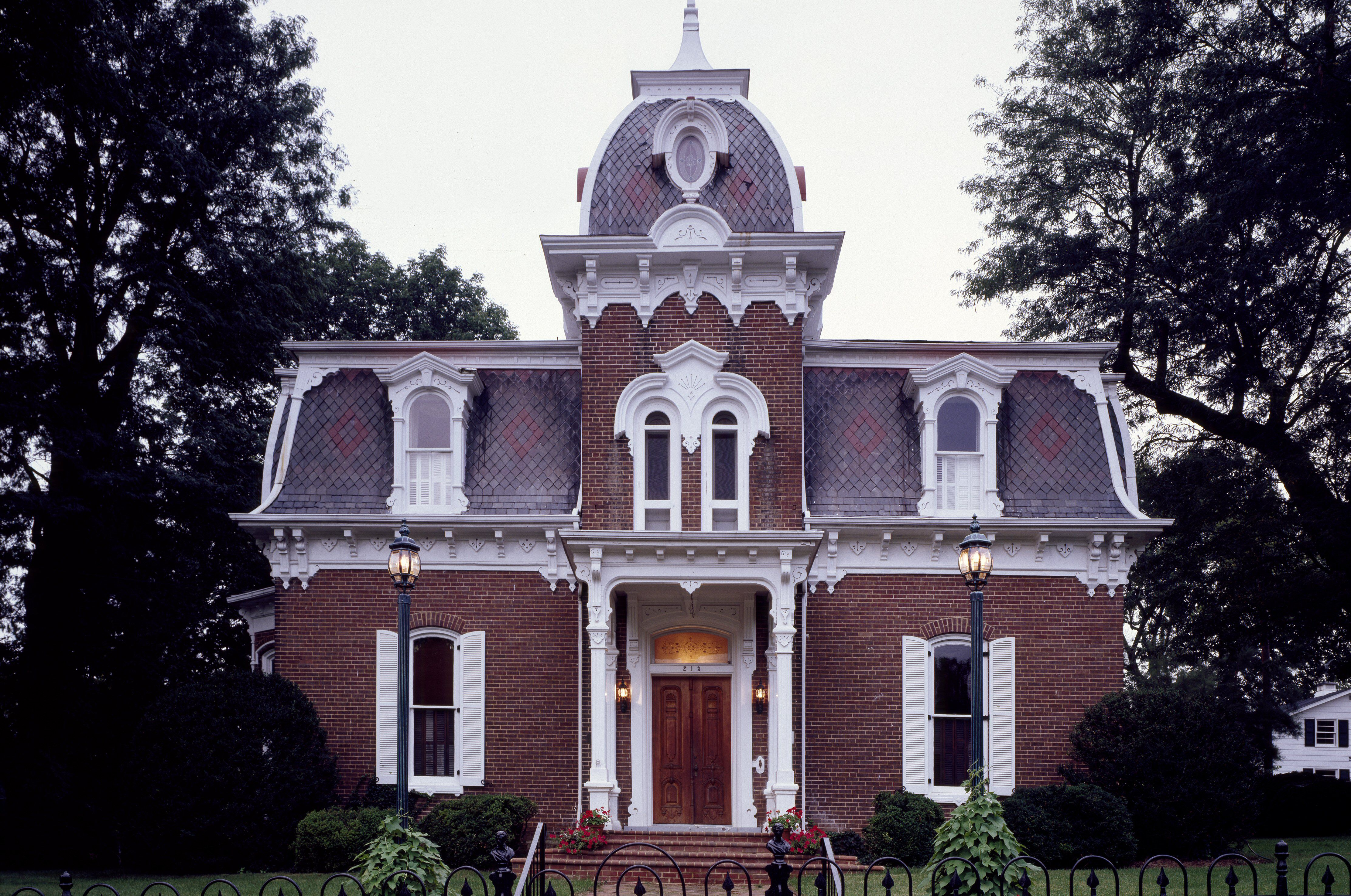 The Second-Empire-style ornate home, mansard roof, dormers, symmetrical, center square tower