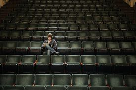 Man with notebook in movie theater