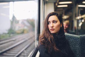Vintage toned portrait of a woman in Berlin metro train