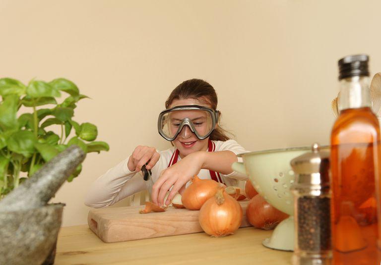 Girl Peeling Onions Wearing Goggles