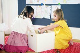 Kids putting toys away