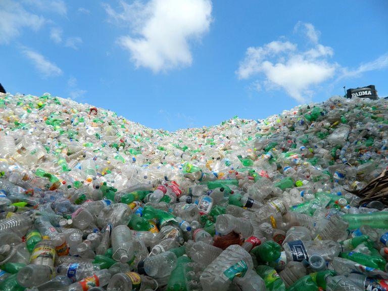 Heap of plastic bottles against sky
