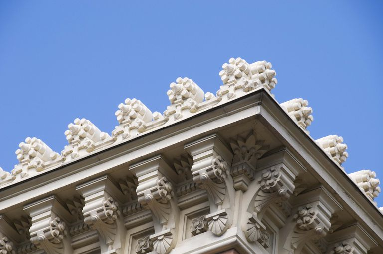 Detail of a building cornice in downtown Madrid, Spain