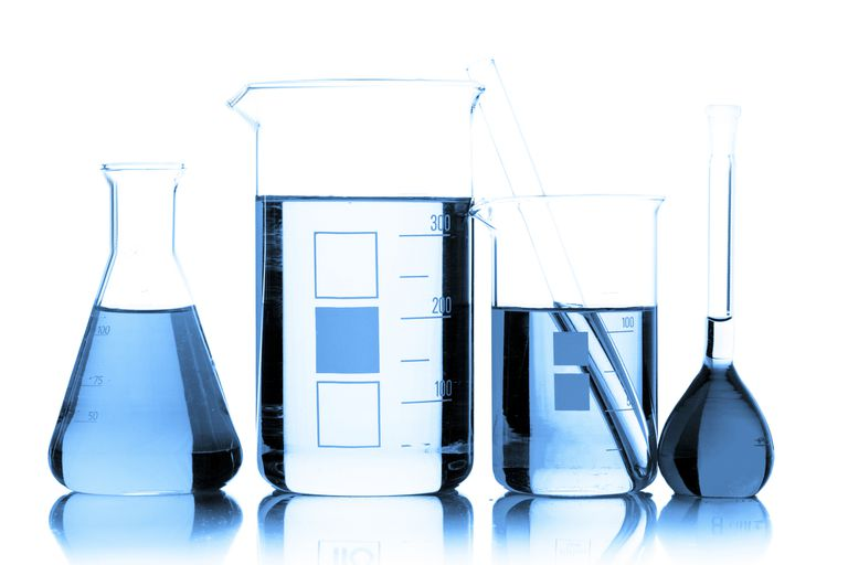 Chemistry glassware containing blue liquids