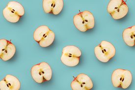 High angle view of apples cut in half revealing insides