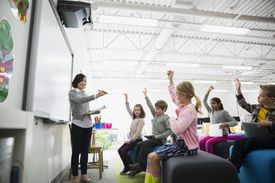 Teacher pointing to students in class