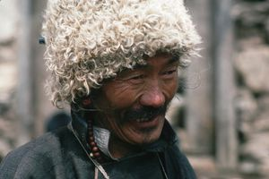 A picture of a Sherpa wearing a wooly hat in Namche Bazaar.