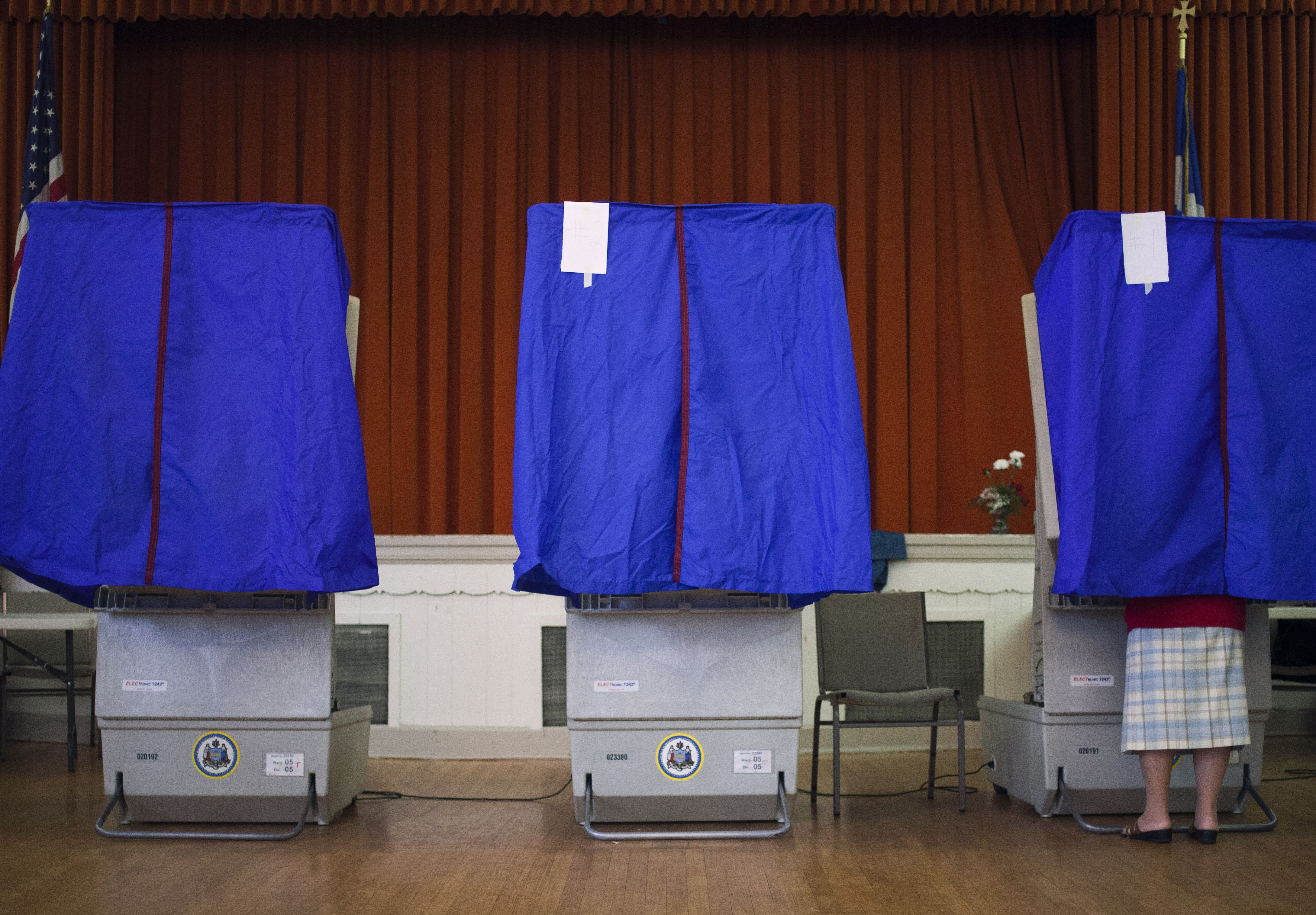 A voter casts her ballot in a voting booth during the Pennsylvania Republican presidential primary in April 2012 in Philadelphia
