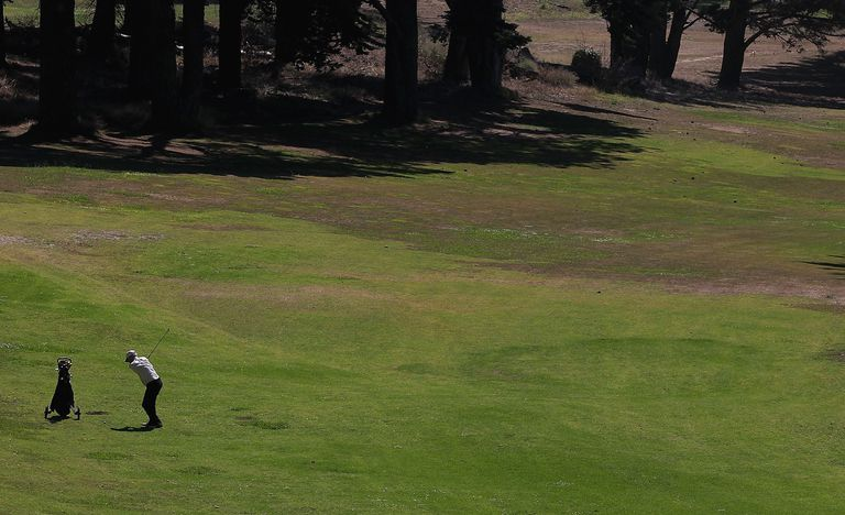 A golf course fairway with tight lies visible