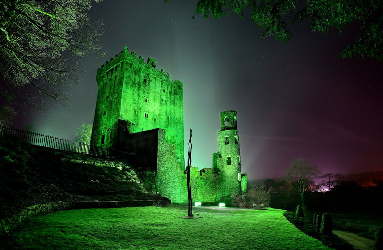 Blarney Castle illuminated by green light in County Cork, Ireland
