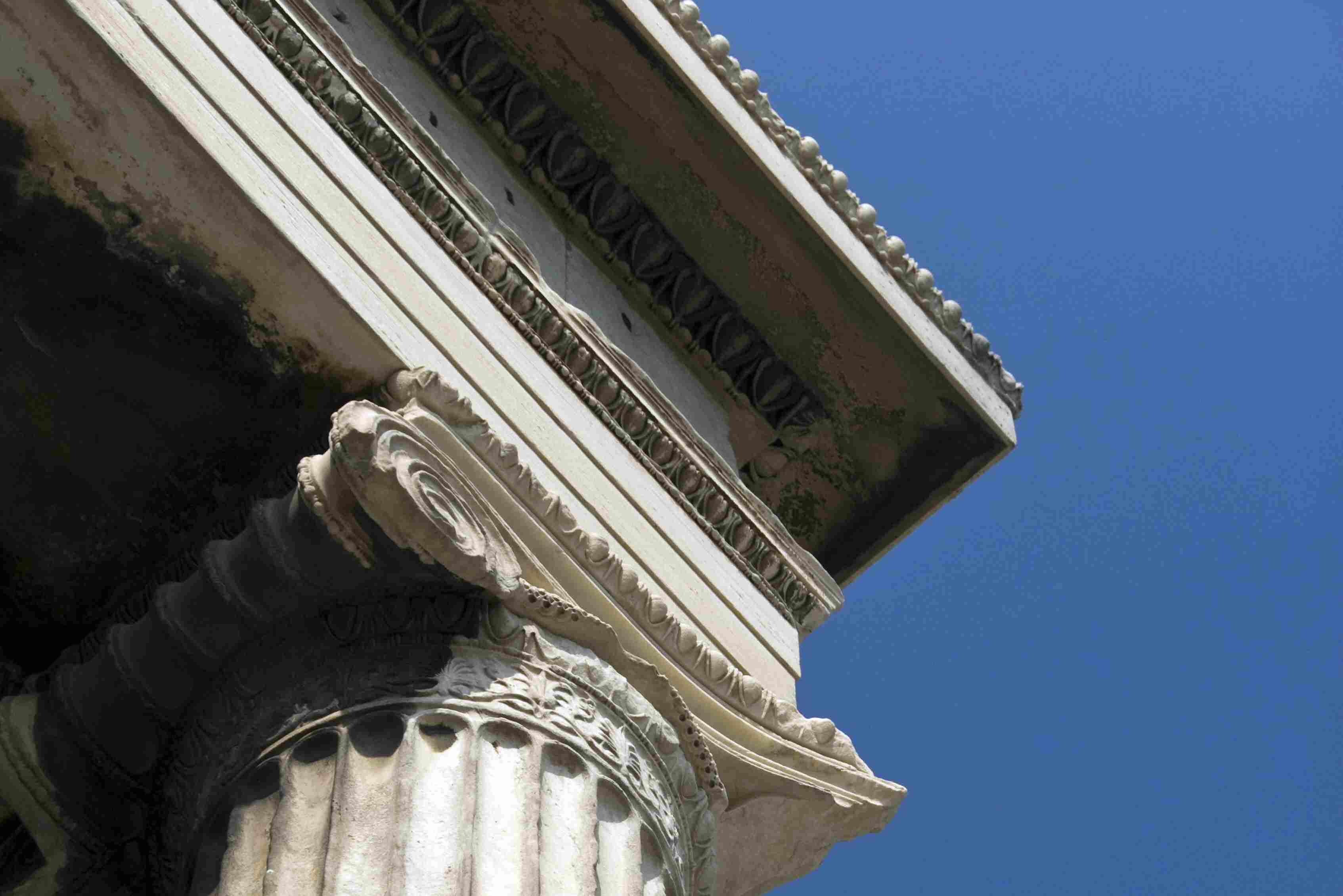 Detail of the marble Ionic columns, architrave, frieze and cornice of the Erechtheion on the Acropolis, Athens, Greece