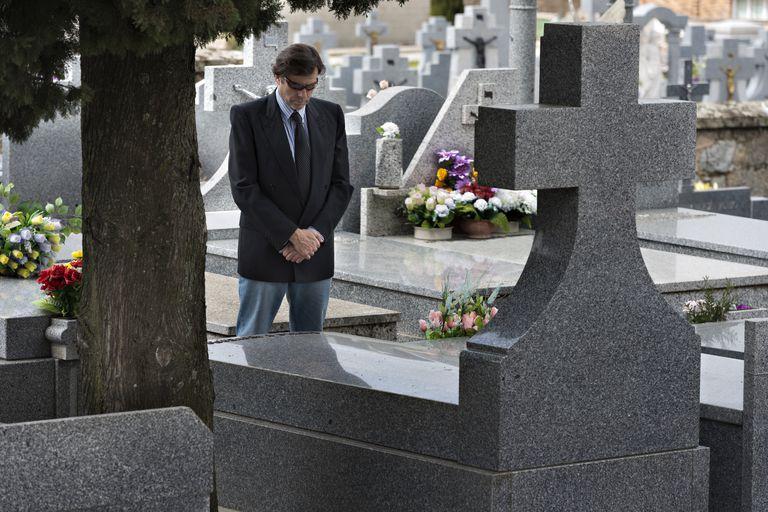 A man in a cemetery.